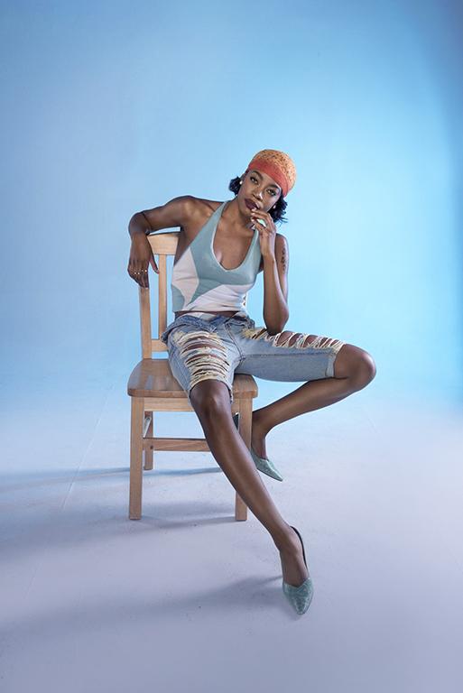 african american fashion photographer captures model in portfolio shoot