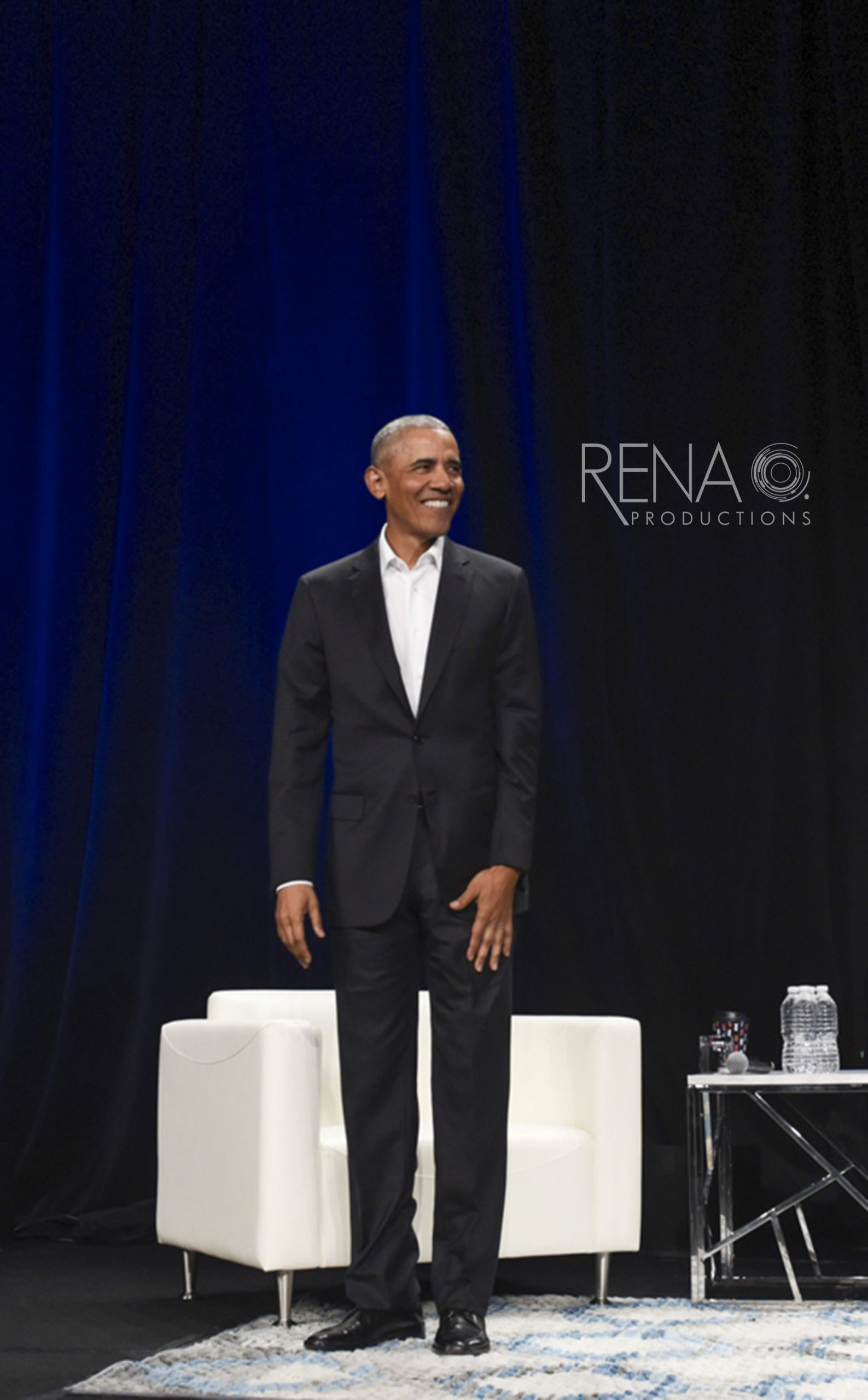 Barack Obama speaking at a conference